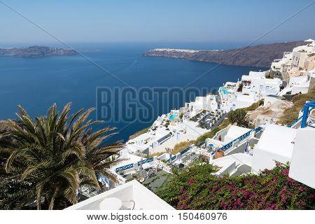 View of Imerovigli village with typical white Greek houses on Santorini island Greece.
