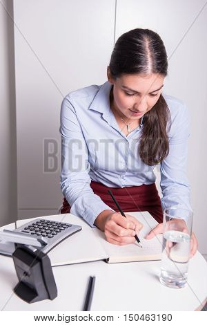 young professional female is working under time pressure