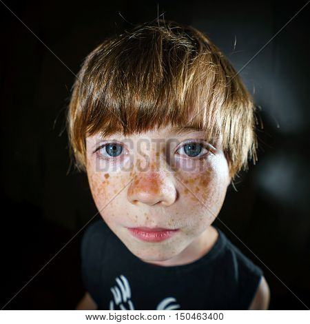 Emotive portrait of red-haired freckled boy actor portfolio childhood concept