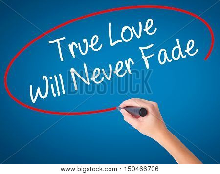 Women Hand Writing True Love Will Never Fade With Black Marker On Visual Screen