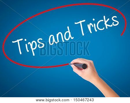 Women Hand Writing Tips And Tricks With Black Marker On Visual Screen