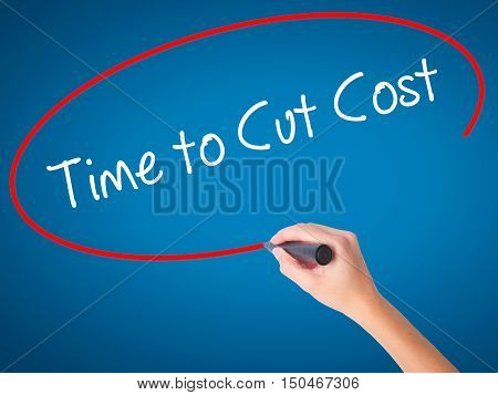 Women Hand Writing Time To Cut Cost With Black Marker On Visual Screen