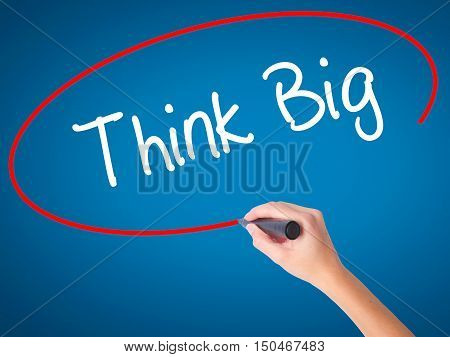 Women Hand Writing Think Big With Black Marker On Visual Screen