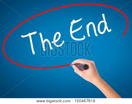 Women Hand Writing The End With Black Marker On Visual Screen