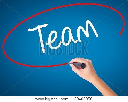 Women Hand Writing Team With Black Marker On Visual Screen