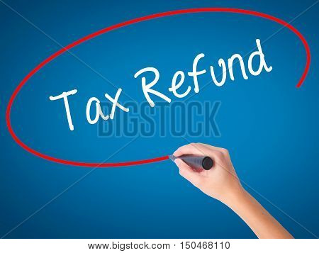 Women Hand Writing Tax Refund With Black Marker On Visual Screen