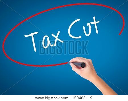 Women Hand Writing Tax Cut With Black Marker On Visual Screen