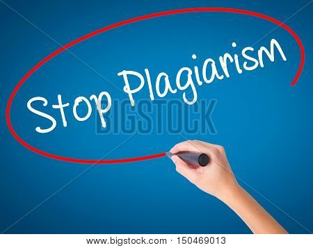 Women Hand Writing Stop Plagiarism With Black Marker On Visual Screen