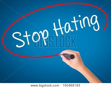 Women Hand Writing Stop Hating  With Black Marker On Visual Screen