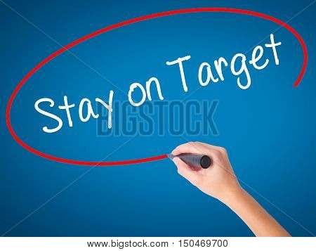 Women Hand Writing Stay On Target With Black Marker On Visual Screen.