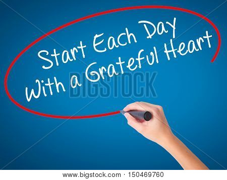Women Hand Writing Start Each Day With A Grateful Heart With Black Marker On Visual Screen