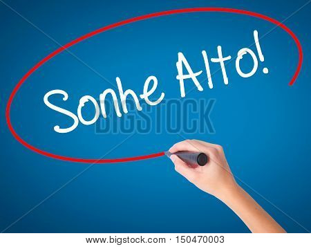 Women Hand Writing Sonhe Alto! (dream Big In Portuguese) With Black Marker On Visual Screen