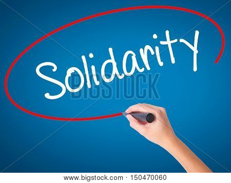 Women Hand Writing Solidarity  With Black Marker On Visual Screen