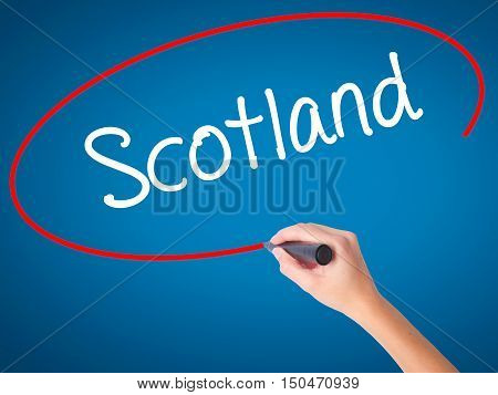 Women Hand Writing Scotland With Black Marker On Visual Screen.