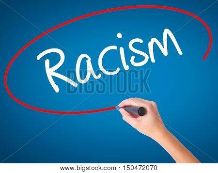 Women Hand Writing Racism With Black Marker On Visual Screen.