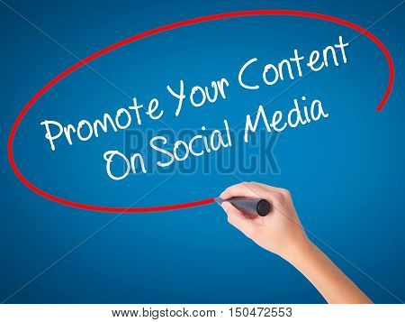 Women Hand Writing Promote Your Content On Social Media  With Black Marker On Visual Screen