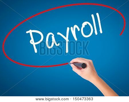 Women Hand Writing Payroll With Black Marker On Visual Screen