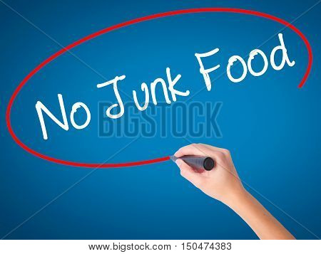 Women Hand Writing No Junk Food With Black Marker On Visual Screen