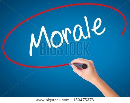 Women Hand Writing Morale With Black Marker On Visual Screen