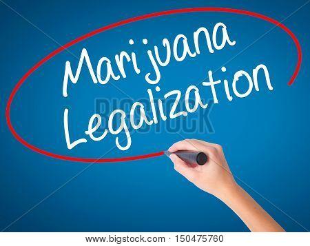 Women Hand Writing Marijuana Legalization With Black Marker On Visual Screen