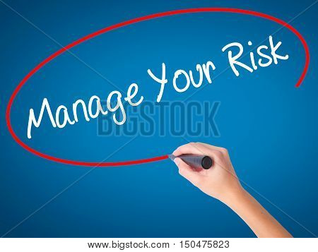Women Hand Writing Manage Your Risk With Black Marker On Visual Screen