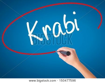 Women Hand Writing Krabi  With Black Marker On Visual Screen.