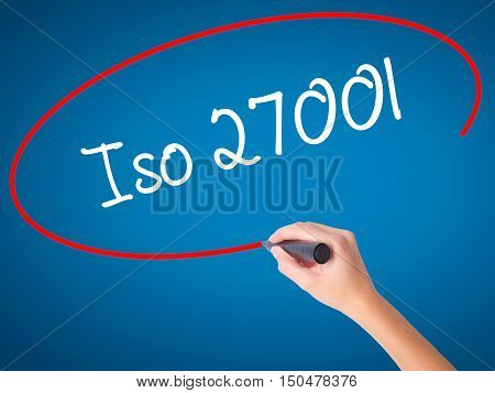 Women Hand Writing Iso 27001  With Black Marker On Visual Screen