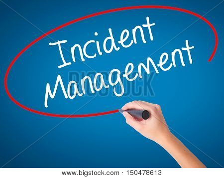 Women Hand Writing Incident Management With Black Marker On Visual Screen