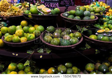 Fresh fruit store show in super market orange basket on shelf with price this kind of fruits rich vitamin c good for health