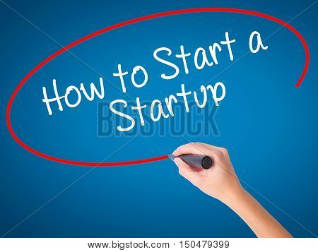 Women Hand Writing How To Start A Startup With Black Marker On Visual Screen