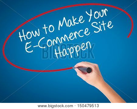 Women Hand Writing How To Make Your E-commerce Site Happen With Black Marker On Visual Screen.