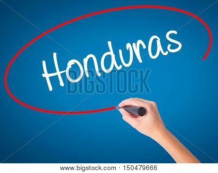 Women Hand Writing Honduras With Black Marker On Visual Screen
