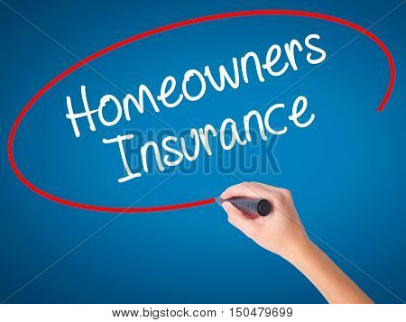 Women Hand Writing Homeowners Insurance With Black Marker On Visual Screen