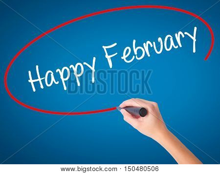 Women Hand Writing Happy February With Black Marker On Visual Screen