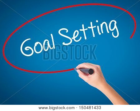 Women Hand Writing Goal Setting  With Black Marker On Visual Screen