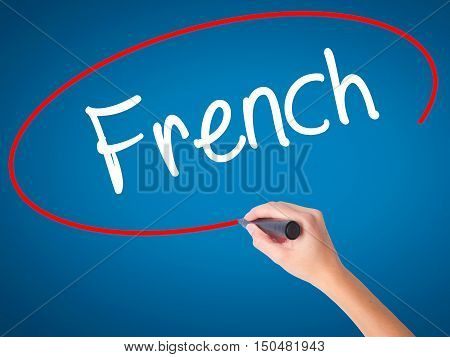Women Hand Writing French With Black Marker On Visual Screen