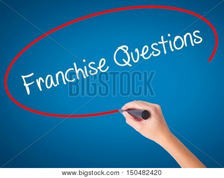 Women Hand Writing Franchise Questions With Black Marker On Visual Screen