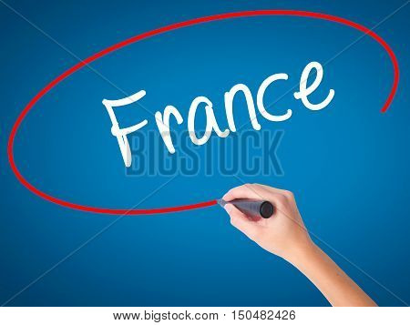 Women Hand Writing France With Black Marker On Visual Screen