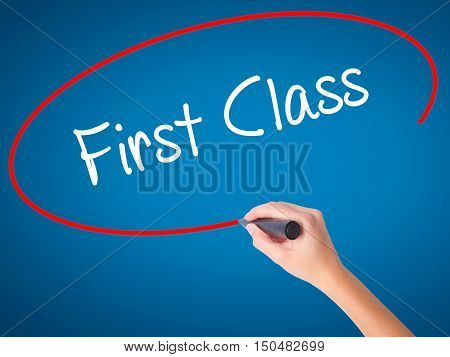 Women Hand Writing First Class With Black Marker On Visual Screen