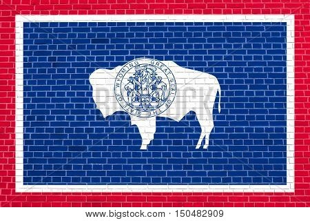 Wyomingite official flag symbol. American patriotic element. USA banner. United States of America background. Flag of the US state of Wyoming on brick wall texture background, 3d illustration
