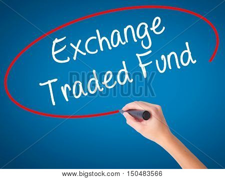 Women Hand Writing Exchange Traded Fund With Black Marker On Visual Screen.