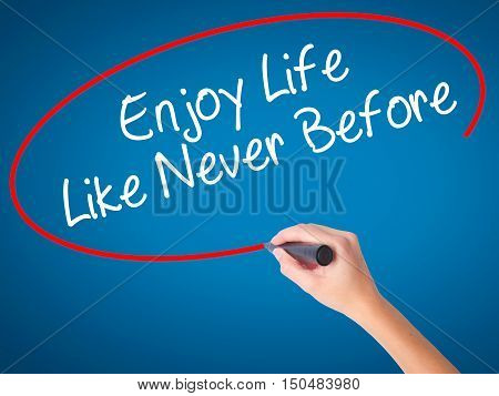 Women Hand Writing Enjoy Life Like Never Before With Black Marker On Visual Screen