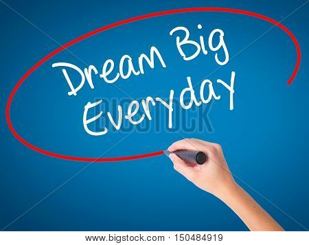 Women Hand Writing Dream Big Everyday With Black Marker On Visual Screen