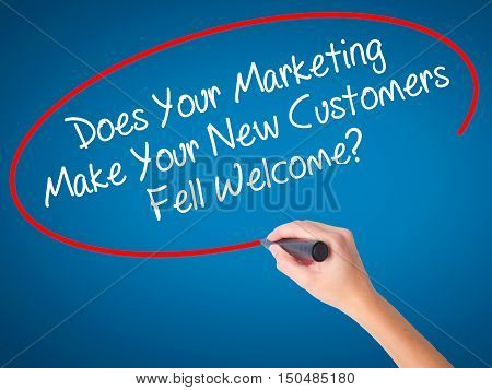 Women Hand Writing Does Your Marketing Make Your New Customers Fell Welcome?  With Black Marker On V