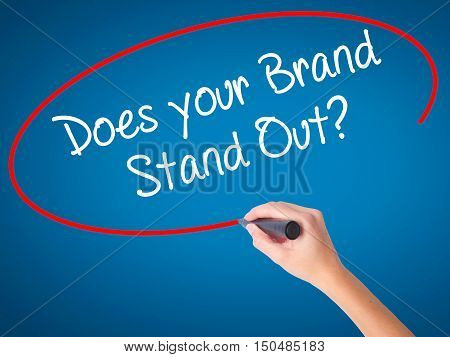 Women Hand Writing Does Your Brand Stand Out? With Black Marker On Visual Screen