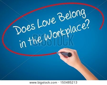 Women Hand Writing Does Love Belong In The Workplace? With Black Marker On Visual Screen