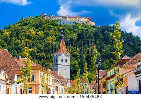 """Fortified Church architecture in Rasnov town medieval fortress of Transylvania """"Cetate"""" in fall season Brasov Romania poster"""