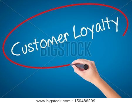 Women Hand Writing Customer Loyalty With Black Marker On Visual Screen