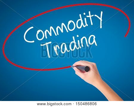 Women Hand Writing Commodity Trading With Black Marker On Visual Screen.
