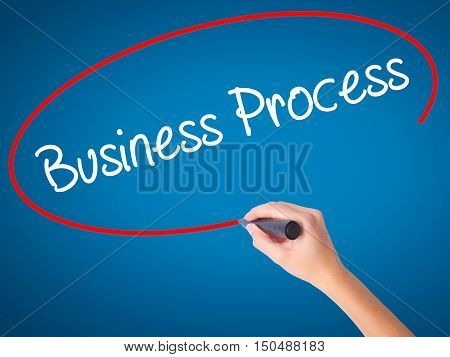 Women Hand Writing Business Process  With Black Marker On Visual Screen.